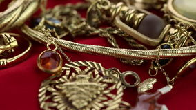Panning through jewelry. A many luxury accessories stock video footage