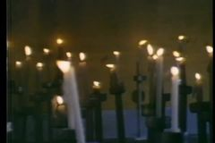 Panning large group of burning candles stock footage