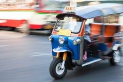 Panning of man riding tuk-tuk Royalty Free Stock Photos