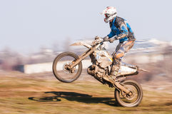 Panning with motocross. Motocross racer with mud on a whell stock photo