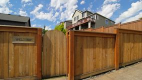 Panning movie of wood fence with entrance gate to garden an welcome sign 1080p hd stock video