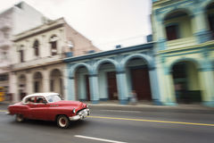 Panning with old car on streets of Havana, Cuba Stock Photos