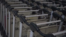 Panning over airport luggage cart.  stock footage
