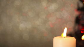 Panning over candle and christmas tree lights stock footage