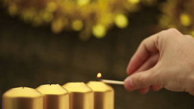 Panning over hand lighting christmas candles stock video