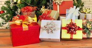 Panning scene video of colorful gift boxes. Panning scene video of colorful gift boxes that decorated by gorgeous bows, then camera zoom in to tha left box stock video footage