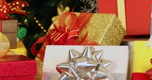 Panning scene video of colorful gift boxes. Panning scene video of colorful gift boxes that decorated by gorgeous bows, Christmas tree decorated by ornaments stock video