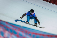 Panning shot athlete snowboarder coming down mountain Royalty Free Stock Photography
