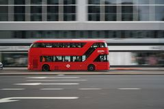 Panning shot of double-decker bus running on Edgware Road early in the morning. London,United Kingdom-May 30, 2017:A double-decker bus is a bus that has two Royalty Free Stock Photo