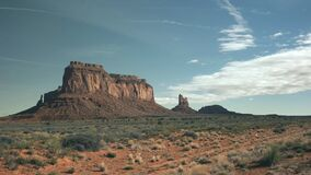 A panning shot of eagle mesa at monument valley in utah