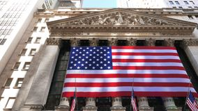 Panning shot of the exterior of the Stock Exchange on Wall Street. In New York City stock footage