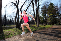 Panning shot of a female runner running Royalty Free Stock Photos