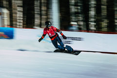 Panning shot girl snowboarder athlete after finish Royalty Free Stock Photography