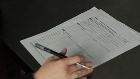 Panning shot of health Insurance Marketplace tax form. Woman filling out a Health Insurance tax form in 1080p stock footage