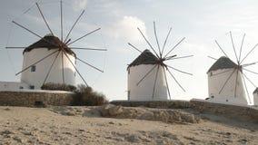 Panning shot of the historic windmills on mykonos, greece. Panning shot of the historic windmills on the island of mykonos, greece stock video