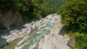 Panning shot of landscape with river. Panning shot of landscape with mountain river stock video footage