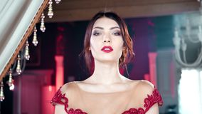 Panning shot medium closeup playful adorable seductive young woman posing at vintage luxury interior