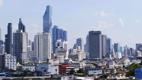 Panning shot of modern building with sky in Bangkok, Thailand stock video