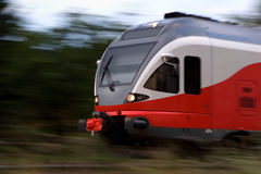 Panning shot of a modern high speed train. Panning shot of a red high speed train. Natural motion blur, no filters Stock Images