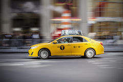 Panning shot of a NYC Taxi Cab Stock Photography