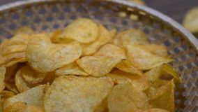Potato chips in a slowly rotating bowl stock footage