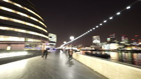 Panning shot from Queens Walk to City of London skyline stock footage