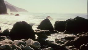 Panning shot of sea and rocks stock video footage