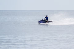 Panning shot of a wave runner royalty free stock images