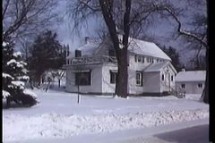 Panning snow covered town stock video