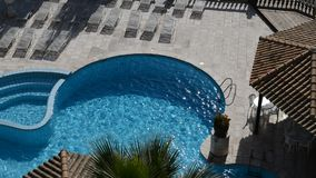 Panning the swimming pool and jacuzzi at luxury hotel stock video footage