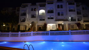 Panning of swimming pool at the luxury hotel in night illumination. Mallorca island, Spain stock footage