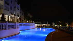 Panning of swimming pool at the luxury hotel in night illumination. Mallorca island, Spain stock video