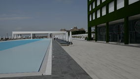 Panning the swimming pool at the modern luxury hotel stock video footage
