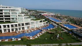 Panning the swimming pool near beach. At the luxury hotel, Antalya, Turkey stock video footage