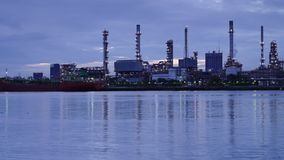 Panning Time-lapse sunrise of Oil refinery with reflection, petrochemical plant stock video