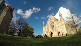 Panning timelapse from Cathedral to Abbey Gateway with stormy clouds stock video footage