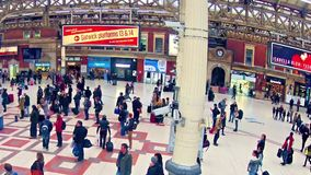 Panning timelapse of Commuters inside Victoria Railway Station in London, UK stock video