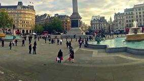 Panning timelapse of commuters on Trafalgar square in London, UK stock footage