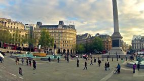 Panning timelapse of commuters on Trafalgar square in London, UK stock video