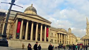 Panning timelapse of commuters on Trafalgar square National Gallery in London, UK stock footage