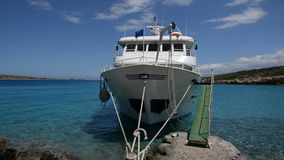 Panning traditional Greek motor yacht for tourists transportation is near beach. Crete, Greece stock video footage