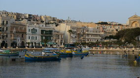 The panning of traditional Maltese boats in sunset. Kalkara, Malta stock video