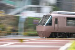 Panning of train at a crossing place Stock Photo