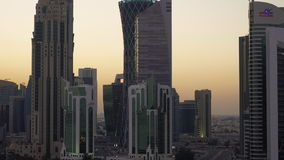 Panning up the skyline of the West Bay financial district of Doha at sunset stock footage