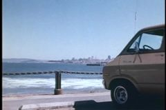 Panning van parked by ocean stock video footage