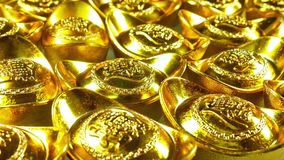 Panning view of the Chinese gold ingots. Foreign text means rich,luck and blessing stock video