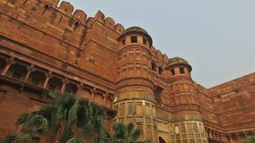 Walls of the Fort of Agra - India. Panning view of the high sandstone walls of the historical Fort of Agra, India - a UNESCO world heritage site stock video