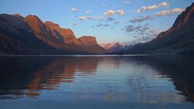 Panning view of St Mary Lake Glacier National Park at sunrise hour. This is a panning view of St Mary Lake in Glacier National Park at sunrise hour stock video