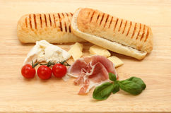 Pannini ingredients on a board Stock Photos