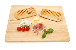 Pannini ingredients on a board Stock Photography
